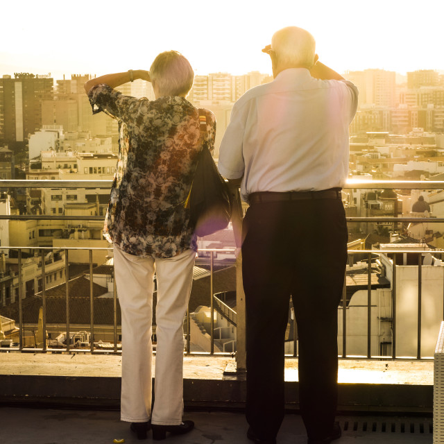 """Older couple on hotel Rooftop"" stock image"