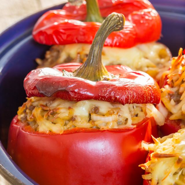 """Baked stuffed peppers with meat sauce and cheese"" stock image"