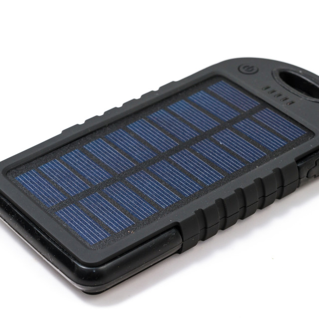 """Portable solar charger for smart phone"" stock image"