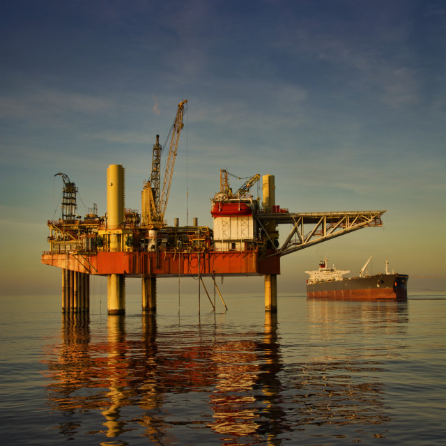 """sunset view at sea oilfield"" stock image"
