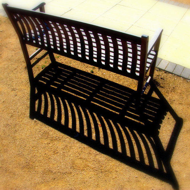 """""""Park bench with shadows"""" stock image"""