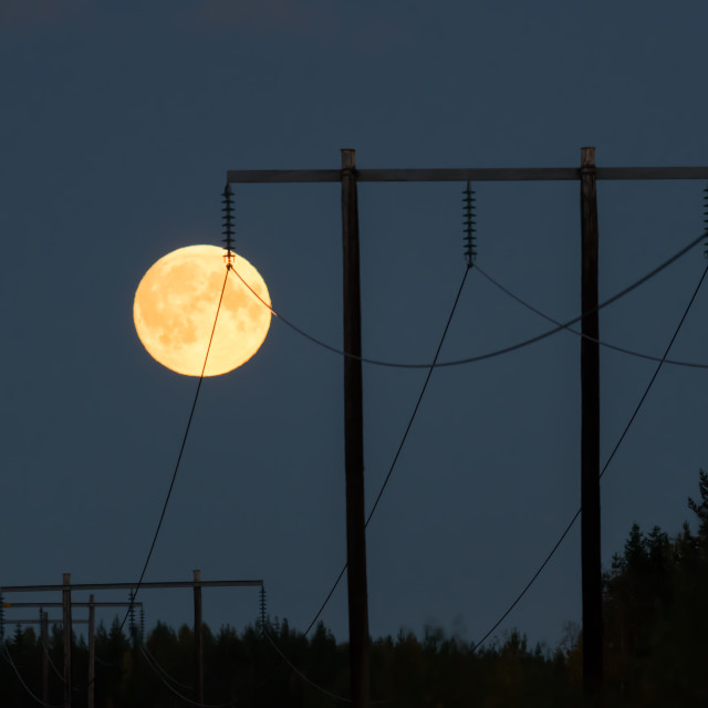 """Moon and power lines"" stock image"