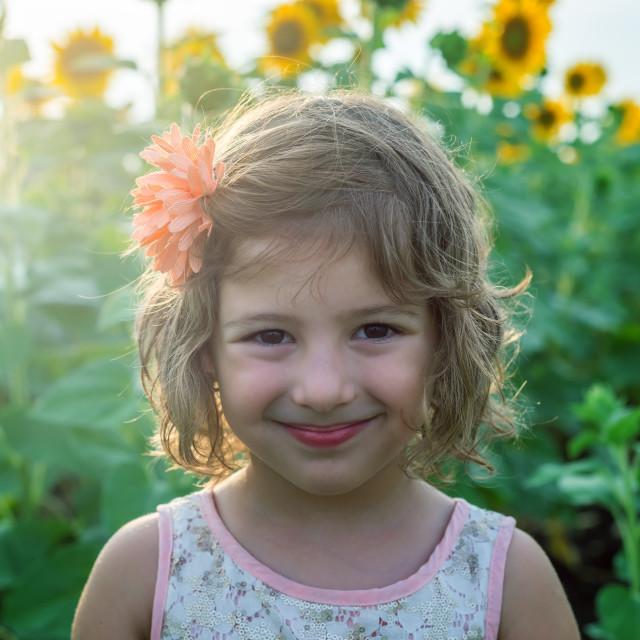 """happy cute girl among sunflowers"" stock image"