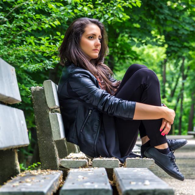 """beautiful woman sitting on the bench"" stock image"