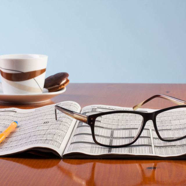 """""""Books, glasses and cup of coffee on a wooden table"""" stock image"""
