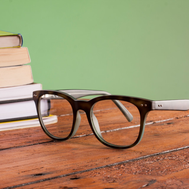"""Books and glasses on a wooden table"" stock image"
