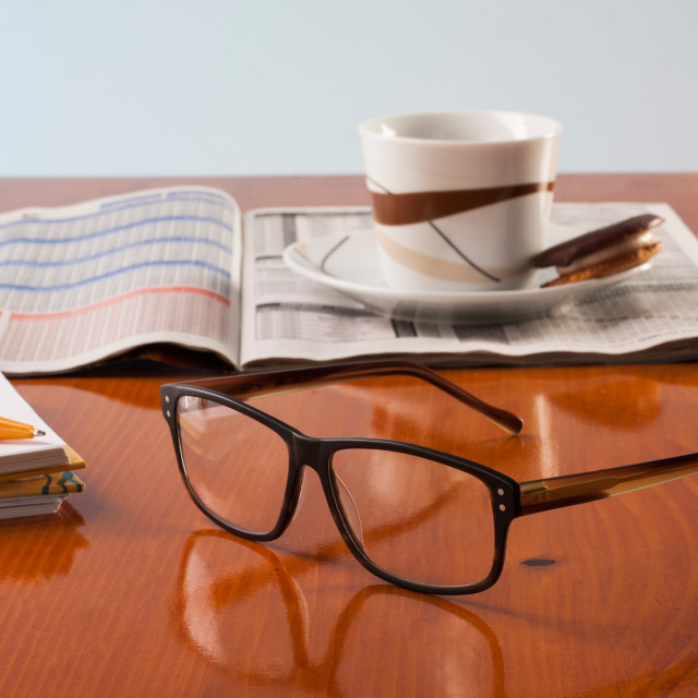 """Books, glasses and cup cafe co on a wooden table"" stock image"
