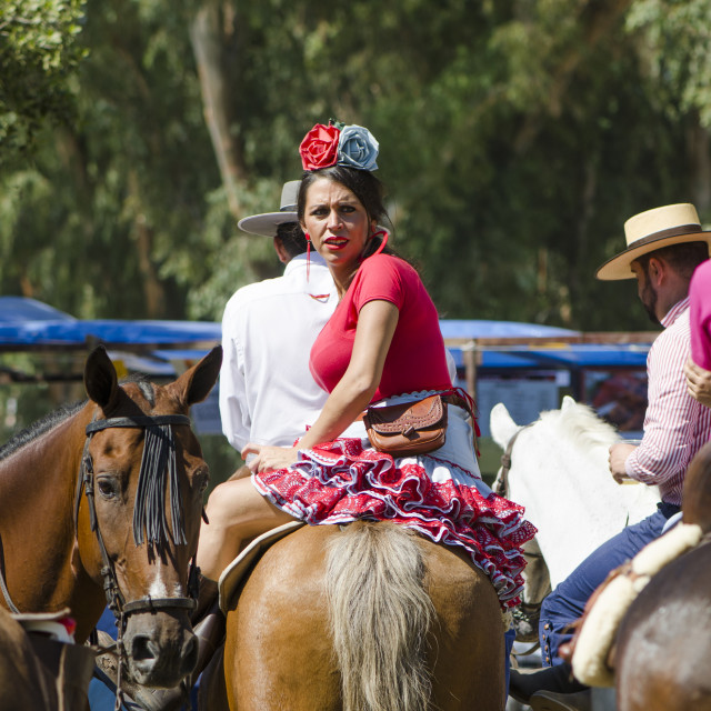 """Horse riding in traditional spanish dress"" stock image"