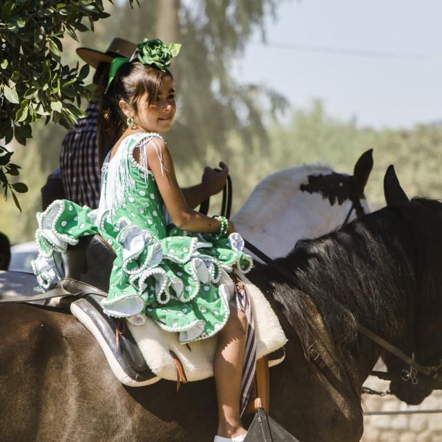 """""""Little Girl on horse in flamenco dress"""" stock image"""
