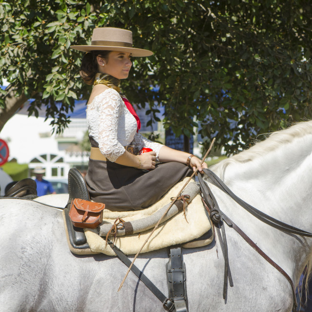 """Girl on horse wearing Cordobes hat in traditional spanish dress"" stock image"