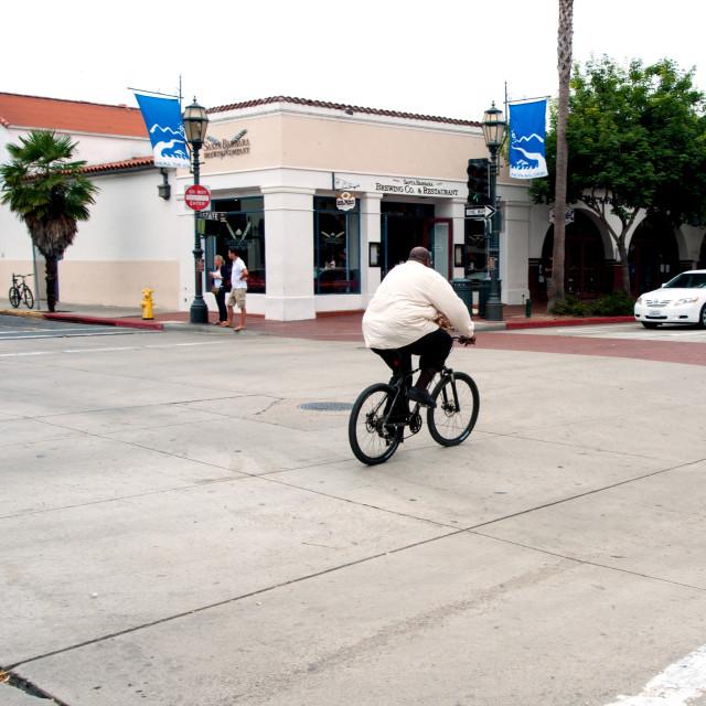 """Big man on a bike"" stock image"