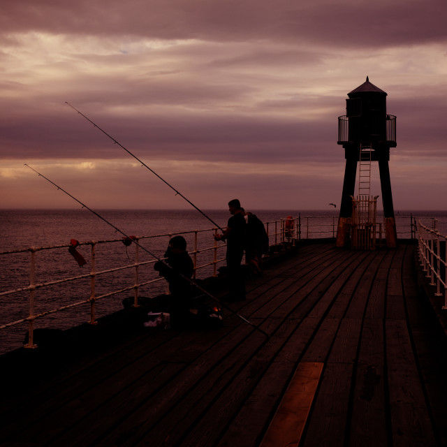 """""""Night Fishing from the Pier"""" stock image"""