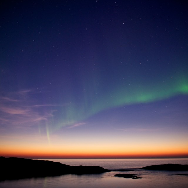 """""""northern Lights over sunset"""" stock image"""