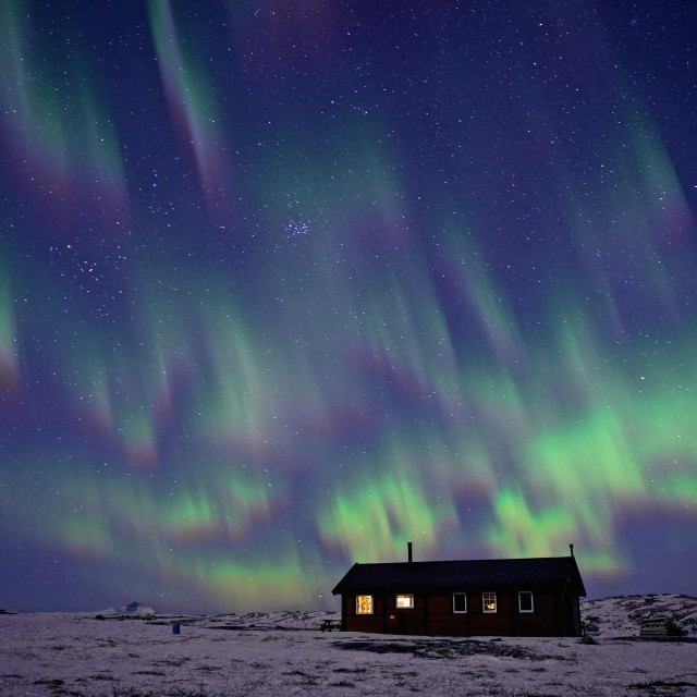 """Aurora Borealis over house"" stock image"