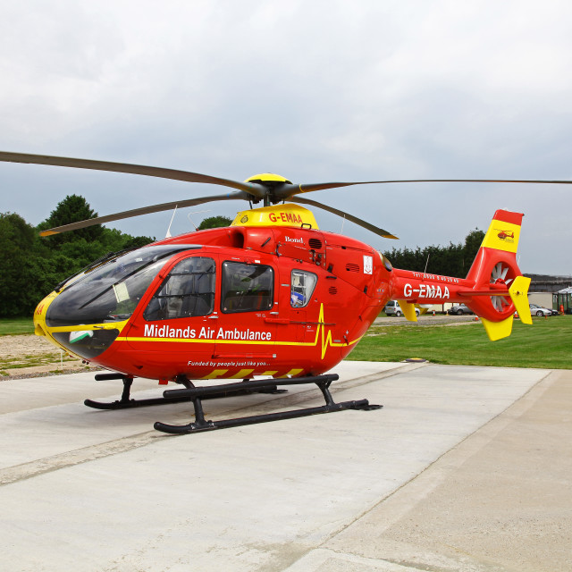 """A Eurocopter EC135 helicopter used by the East Midlands Air Ambulance emergency rescue service"" stock image"