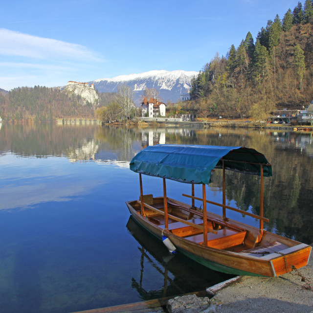 """A Pletna, a covered wooden rowing boat on Lake Bled Slovenia"" stock image"