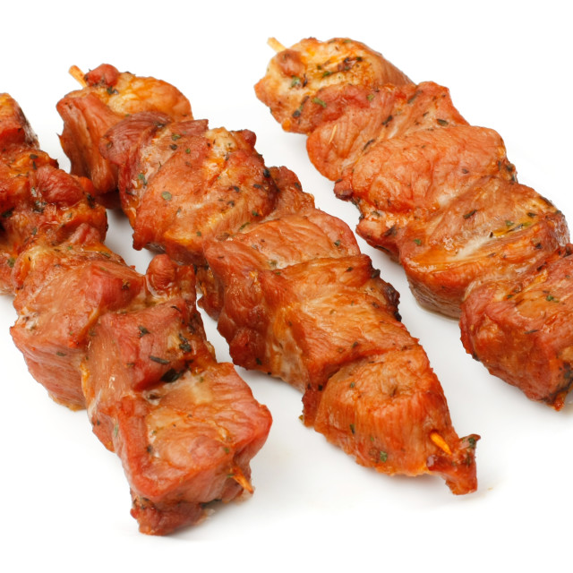 """Chicken skewers isolated over white plate."" stock image"