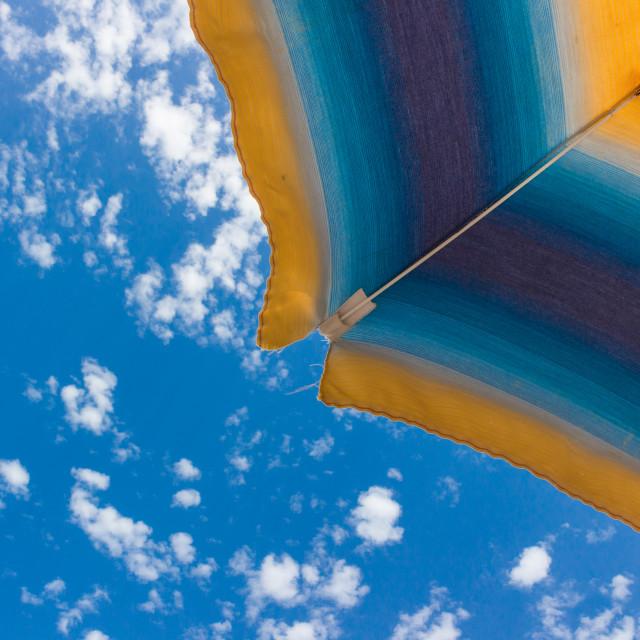 """Beach umbrella a on sunny summer day"" stock image"