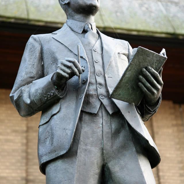 """A statue of Reginald Mitchell, designer of the Spitfire aeroplane, outside the Potteries Museum and Art gallery, Stoke-on-Trent"" stock image"
