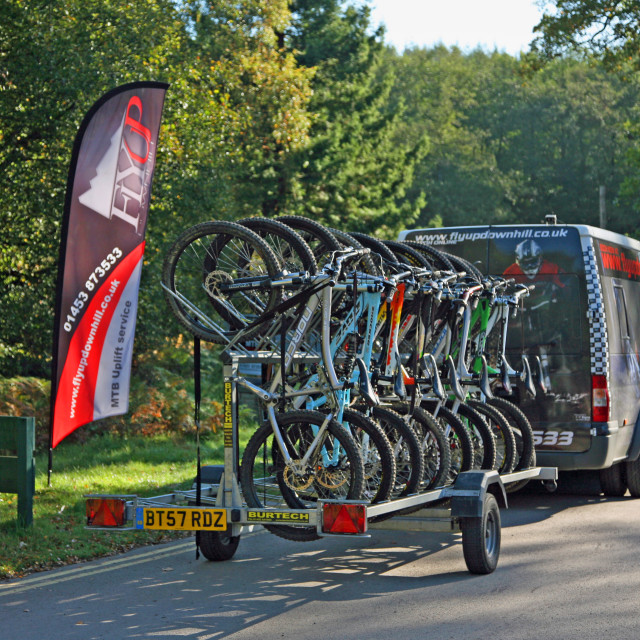 """""""A cycle uplift service van and trailer in the Forest of Dean Monmouth Wales"""" stock image"""