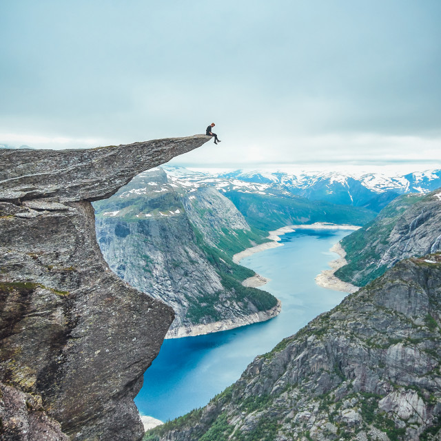 """Sitting on the tip of Trolltunga"" stock image"