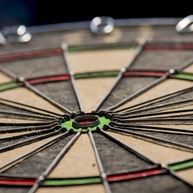 """Close up of a Bulls Eye on a Dart Board"" stock image"