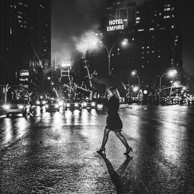 """Woman crossing the street"" stock image"