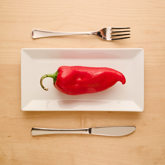 """Vegan low-carb diet raw uncut red pepper on rectangular plate"" stock image"