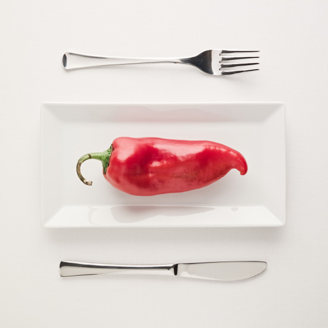 """""""Vegan low-carb diet raw uncut red pepper on rectangular plate"""" stock image"""