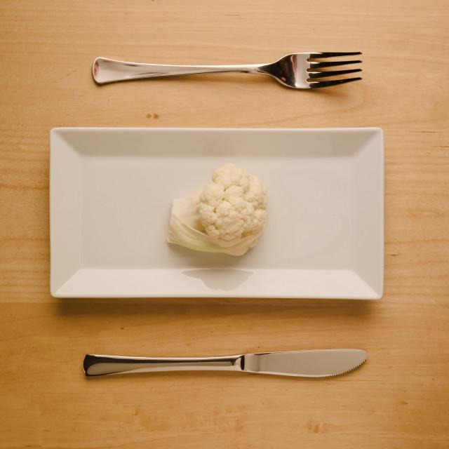 """Vegan low-carb diet raw cauliflower on rectangular plate"" stock image"