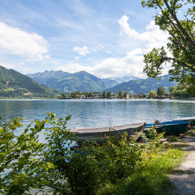 """""""Metal covers Boats on the lake with mountains in the background at Zell am See Austria in summer boat water sunny"""" stock image"""