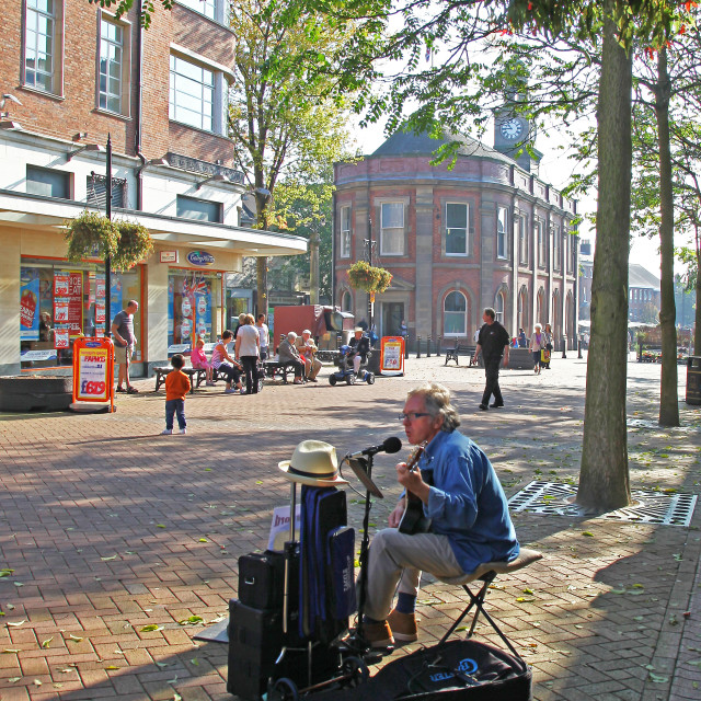 """A street entertainer or busker singing on the street at Newcastle-under-Lyme, Stoke-on-Trent England UK"" stock image"