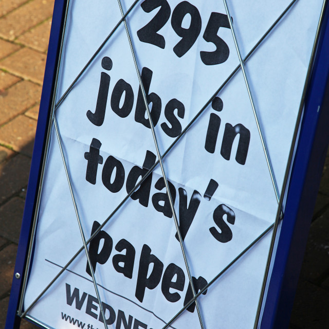 """A newspaper advert A sign billboard in the street advertising jobs in today's paper"" stock image"