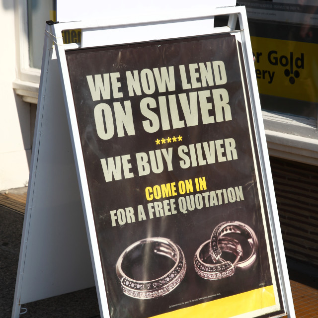 """A pawnbroker's A sign in the street advertising that they lend on silver items"" stock image"