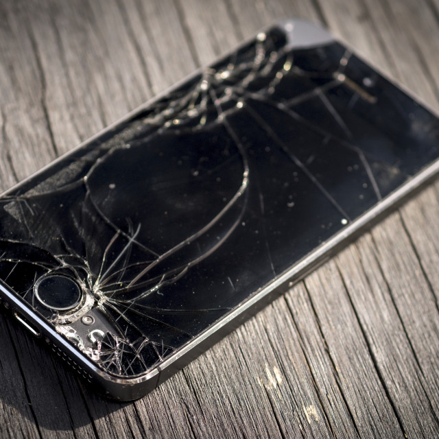 """Apple Iphone 5s with a Broken Screen"" stock image"