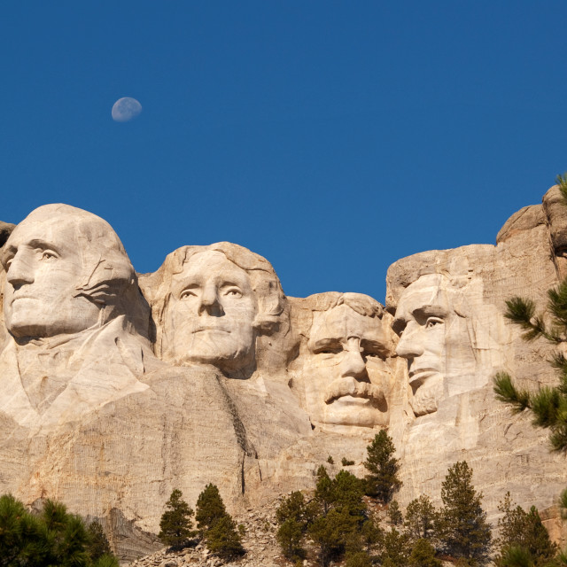"""Moonrise over Mount Rushmore"" stock image"