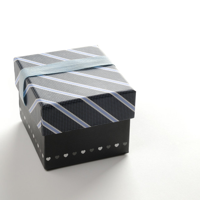 """Black gift box with ribbon and blue lines"" stock image"