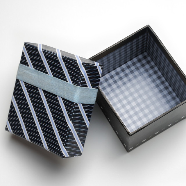 """Open black gift box with ribbon and blue lines Top"" stock image"