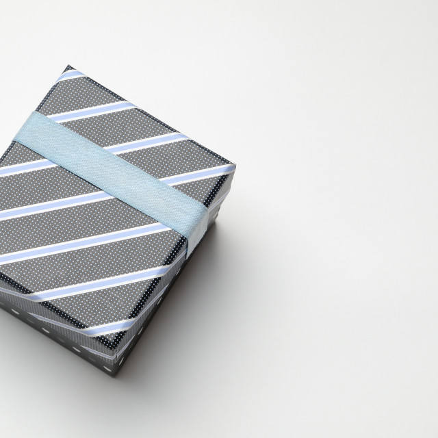 """Black gift box with ribbon and blue lines Top perspective"" stock image"