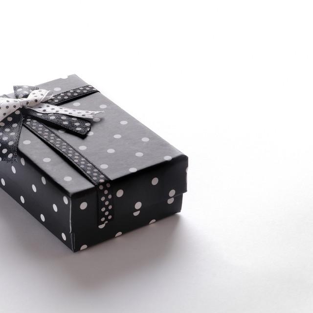 """""""Small black gift box with ribbon and circles"""" stock image"""