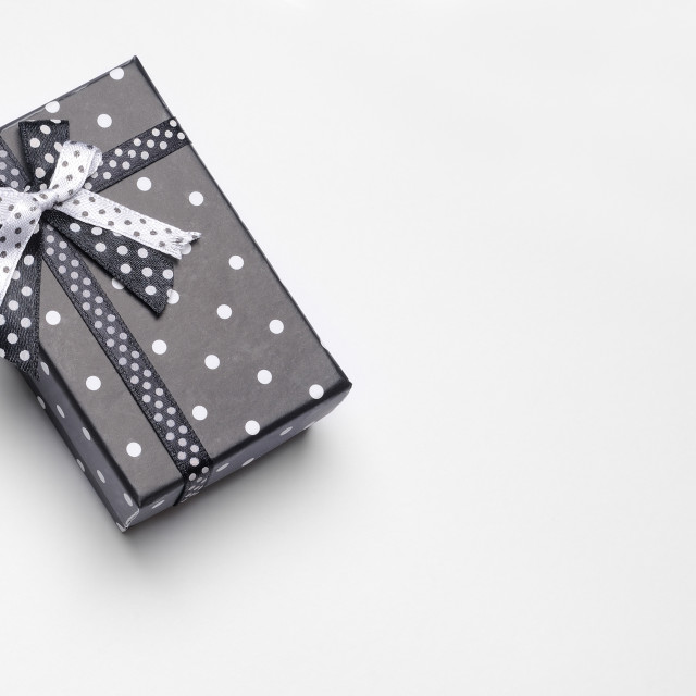 """Small black gift box with ribbon and circles top"" stock image"