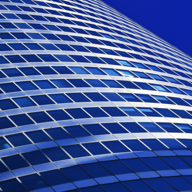 """Modern commercial architecture over blue sky"" stock image"