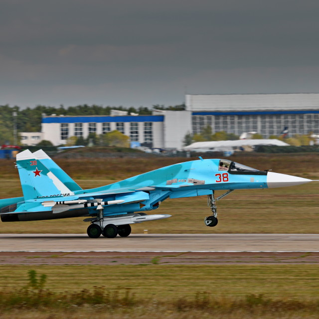 """Armed Su-34 take-off"" stock image"