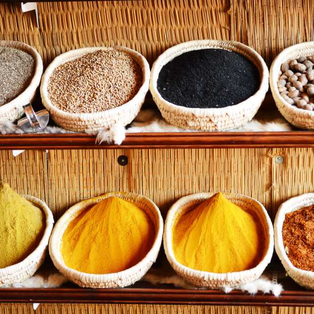 """Spices in Arabic store including turmeric and curry powder"" stock image"
