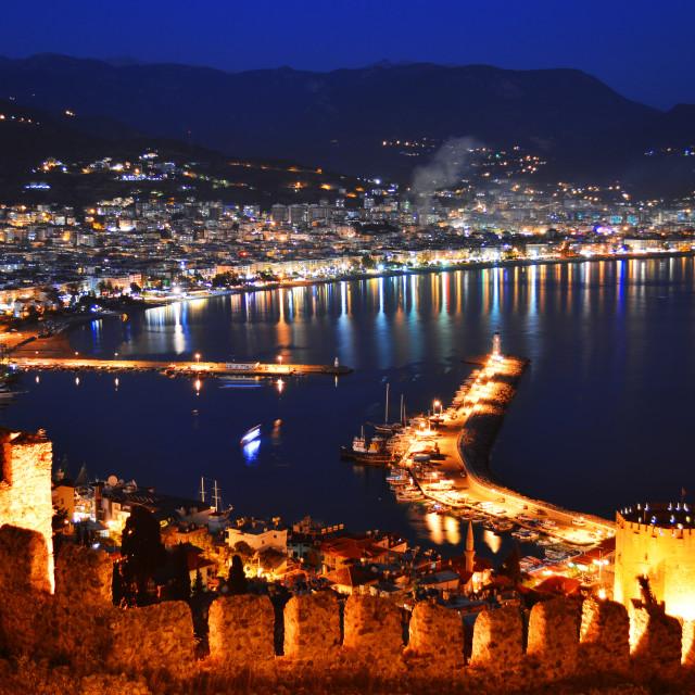 """View of Alanya harbor form Alanya peninsula. Turkish Riviera by night"" stock image"