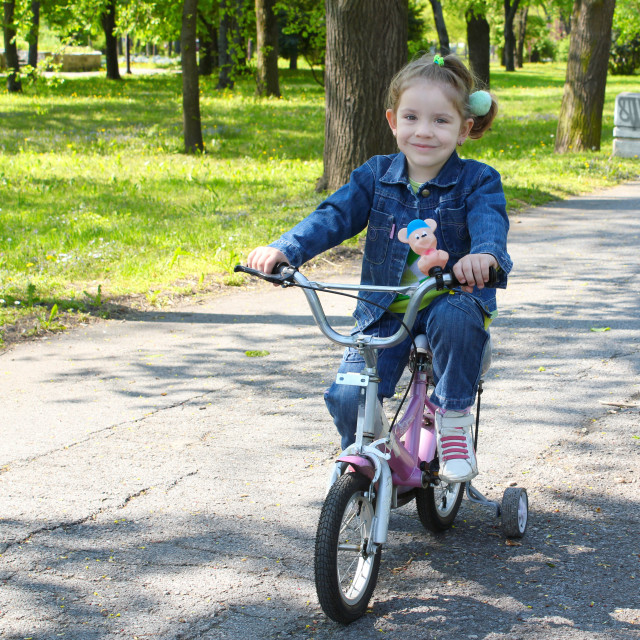 """""""child riding bicycle in park"""" stock image"""