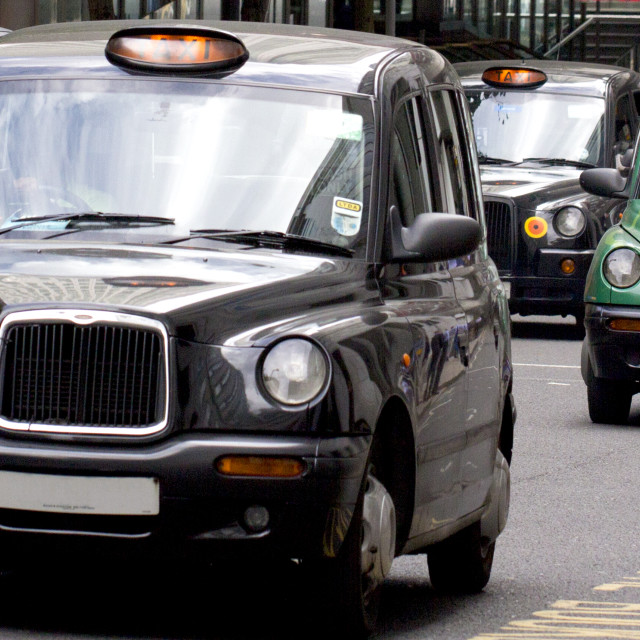 """""""Five London Taxi Cabs"""" stock image"""