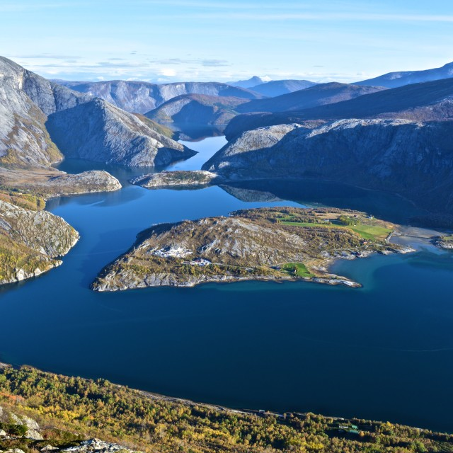 """Fjord with blue water and colorful trees"" stock image"