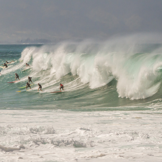 """""""Surfers catching a wave"""" stock image"""