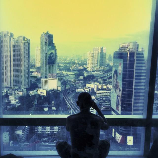 """Man photographing skyline of bangkok, thailand"" stock image"